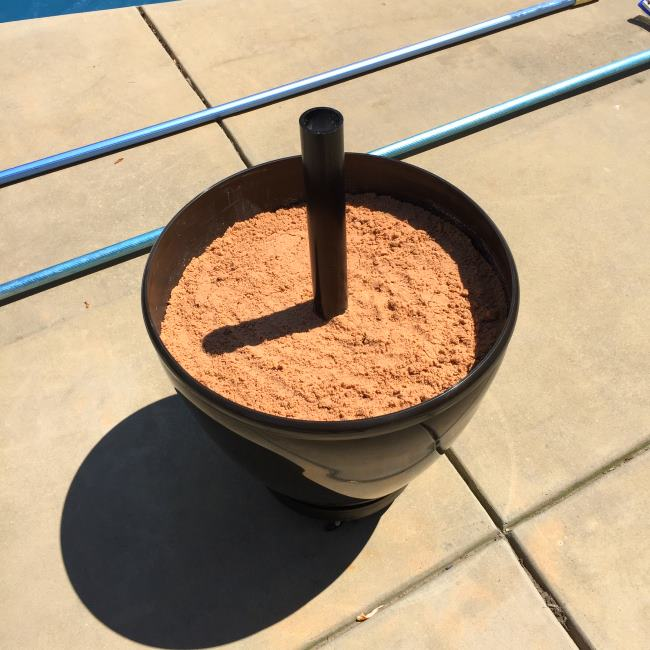 diy umbrella stand with sand